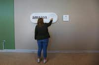 Kaitlyn Howard of Smiths Station, Ala., a student at the University of Alabama at Birmingham, pushes a large Amazon Dash button that's part of Birmingham's campaign to lure Amazon's second headquarters.(Brynn Anderson/The Associated Press)
