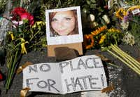 A makeshift memorial of flowers and a photo of Heather Heyer sits in Charlottesville, Va., on Aug. 13. Heyer was killed when a car rammed into a group of people who were protesting the presence of white supremacists who had gathered in the city for a rally.(Steve Helber/The Associated Press)