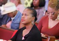 Jacqueline Byrd listens to her husband, Pastor Andre Byrd Sr., preach at the New Covenant Christian Fellowship Church during Sunday service Oct. 15, 2017. She will accompany her husband and the church's choir to Spain later this month.(Ron Baselice/Staff Photographer)