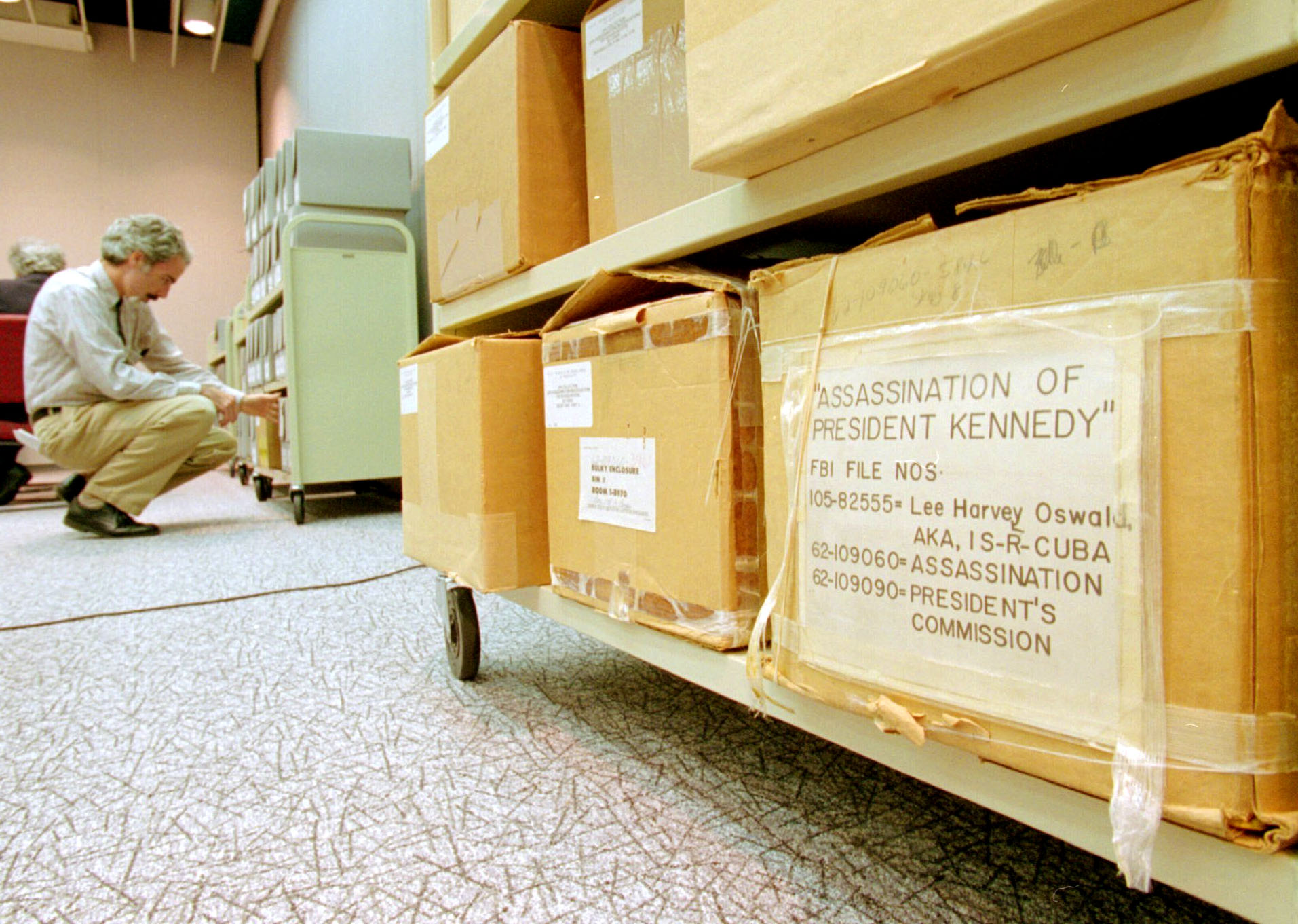 Archivist Ken Hawkins looked over files concerning the assassination of President John F. Kennedy in May 1994 at the National Archives in College Park Md
