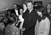 Judge Sarah T. Hughes administered the presidential oath to Lyndon Johnson aboard Air Force One at Love Field after Kennedy's death. Johnson's wife, Lady Bird (background) and the slain president's widow, Jackie Kennedy, were among the witnesses. (Cecil Stoughton/The White House)