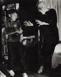 "Jason Works gets a scare from ghoul Craig Faukner, a student at Garland High School, during preview night for the March of Dimes Haunted House in October 1986.(File Photo/<p><span style=""font-size: 1em; background-color: transparent;"">Nuri Vallbona</span></p>)"