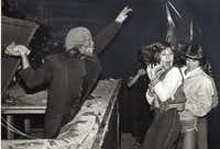 <p>Ghoul Jerry Fleming scares Marie Rossman (center) of Carrollton and Amy Walker at the March of Dimes Haunted House on Halloween Night in 1979.</p>(<p>File Photo</p>/John Rhodes)