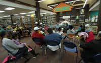 Gene and Peggy Helmick-Richardson entertain children by telling campfire stories in the Zula B. Wylie Library in Cedar Hill.(File Photo/Staff)