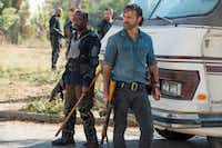 In this image released by AMC, Lennie James portrays Morgan Jones, left, and Andrew Lincoln portrays Rick Grimes in a scene from <i>The Walking Dead</i>. The eighth season premieres Oct. 22. (Gene Page/AMC via AP)(Gene Page/AP)