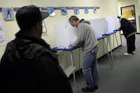 From left to right, Dartanian Lewis and Jay Green voted at the at the Martin Luther King, Jr. Learning Center on March 2, 2010. (Staff/File Photo)