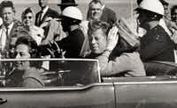 President John F. Kennedy waves from his car in a motorcade approximately one minute before he was shot in Dallas. Riding with Kennedy are First Lady Jacqueline Kennedy, right, Nellie Connally, second from left, and her husband, Texas Gov. John Connally, far left.(Jim Altgens/AP)