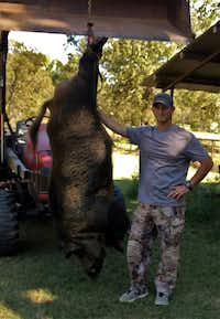 "<p><span style=""font-size: 1em; background-color: transparent;"">Joe Clowers said he killed a 400-plus pound hog that has been terrorizing his property in Union Grove. </span></p>(Gregg County Game Warden Facebook)"