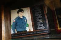 """A plaque to remember George Raffield Jr. is in the lobby of the Midlothian Police Department. Raffield was killed in the line of duty on Oct. 23, 1987. The plaque includes a poem called """"The Dash"""" by Linda Ellis.(Nathan Hunsinger/Staff Photographer)"""