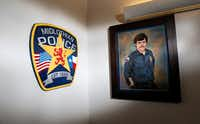 A portrait of George Raffield Jr. by artist James Spurlock is on display at the Midlothian Police Department on Oct. 18, 2017.(Nathan Hunsinger/Staff Photographer)