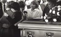 <p>Martha Asbury, the fiancée of slain Midlothian undercover police Officer George Raffield, was comforted by family and friends at his funeral on Oct. 27, 1987, in Waxahachie.</p>(Evans Caglage/Staff Photographer)