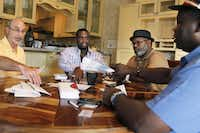 Exoneree and Director of House of Renewed Hope Christopher Scott (second from left) prepared for the organization's first fundraiser with the help of other exonerees (from left) Steven Phillips, Billy J. Smith, and Charles Allen Chatman, at his home in Carrollton in 2012. (Staff/File Photo)