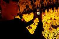 Todd Joyce takes photos in the Yayoi Kusama installation 'All the Eternal Love I Have for the Pumpkins' at the Dallas Museum of Art. (Nathan Hunsinger/Staff Photographer)