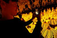 Todd Joyce takes photos in the Yayoi Kusama installation 'All the Eternal Love I Have for the Pumpkins' at the Dallas Museum of Art.(Nathan Hunsinger/Staff Photographer)