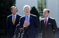 U.S. Senate Majority Whip Sen. John Cornyn (R-Texas) speaks to members of the media as Sen. John Thune (R-S.D.), left, and Sen. Pat Toomey (R-Pa.), right, listen outside the White House after a meeting with President Donald Trump on Wednesday.(Olivier Douliery/TNS)