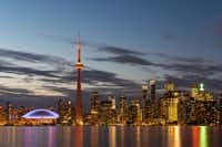 The illuminated Toronto skyline with Lake Ontario in the foreground.(AndresGarciaM/Getty Images/iStockphoto)
