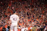 Houston Astros fans cheer as their team closed in on the American League pennant in the ninth inning of Game 7 of the American League Championship Series at Minute Maid Park in Houston on Oct. 21, 2017. The Astros beat New York, 4-0.(Ben Solomon/The New York Times)