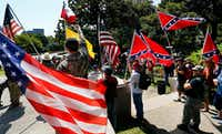 Flag-carrying protesters joined the This is Texas Freedom Force protest over removal of the Robert E. Lee statue on Sept. 16, two days after the statue was moved to Hensley Field.(Tom Fox/Staff Photographer)
