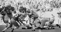 """Dallas Cowboys safety Cliff Harris (43) tries to evade a tackle by San Francisco 49ers running back Larry Schreiber (35) on the opening kickoff of the NFC Championship game on Jan. 2, 1972, at Texas Stadium. The Cowboys would win the game, 14-3, and go shed the """"next year's champions"""" label with their first Super Bowl win, 24-3 over the Miami Dolphins.(1972 File Photo/The Associated Press)"""