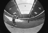 "<p><span style=""font-size: 1em; background-color: transparent;"">A fish-eye view shows the Interior of Texas Stadium as running back Duane Thomas walks onto the field before the stadium's inaugural game, a 44-21 Cowboys win over the New England Patriots, on Oct. 24, 1971. The stadium's unique roof structure covered all the seats but left the playing field exposed to the elements. It was often said that the hole in the roof was designed to allow God to watch his team play.</span></p>(1971 File Photo/The Associated Press)"