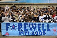 Dallas Cowboys fans cheer for the team while bidding farewell to Texas Stadium on Dec. 20, 2008. Nearly 40 years after it opened, and having hosted many great Cowboys wins, the stadium met an inglorious end as the Cowboys allowed touchdown runs of 77 and 82 yards in the game's final minutes in a 33-24 loss to the Baltimore Ravens.(2008 File Photo/Louis DeLuca)