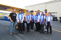 "Lancaster students pose with the plane they built to fly humanitarian missions to impoverished countries.(<p><span style=""font-size: 1em; background-color: transparent;"">Kimberly Simpson</span></p>/<p><span style=""font-size: 1em; background-color: transparent;"">Lancaster ISD</span><br></p><p></p>)"