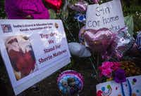 Signs, flowers, balloons and other items collect at a memorial for 3-year-old Sherin Mathews the day her body was found.(Ashley Landis/Staff Photographer)