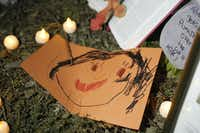 A child's drawing is among the items left at small tribute  for Sherin Mathews.(Ron Baselice/Staff Photographer)
