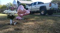 A makeshift memorial sprang up next to the Cedar Hill home where the shooting took place Monday night.(Kyle Martin/Staff)
