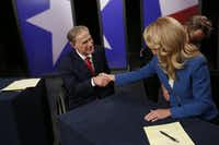 Before their final gubernatorial debate in 2014, Texas Attorney General Greg Abbott and state Sen. Wendy Davis shook hands. (Andy Jacobsohn/Staff Photographer)