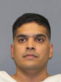 Wesley Mathews, 37, is shown in a Richardson Police Department jail booking photo(Richardson Police Department)