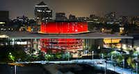 The distinctive red drum of the Margot and Bill Winspear Opera House glowed in the night as the AT&T Performing Arts Center prepared to open in 2009.(Tom Fox/Staff Photographer)
