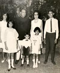 "<p><span style=""font-size: 1em; background-color: transparent;"">Lorraine Christensen's family, the Khans, often hosted holiday dinners. The Khan children grew up in India and England, and the entire family eventually moved to the Irving area. Christensen is at the front right. </span></p>"