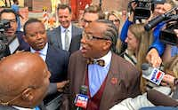 Dallas County Commissioner John Wiley Price talks to the media as he walks out of the the Earle Cabell Federal Building in Dallas. (Jae S. Lee/Staff Photographer)