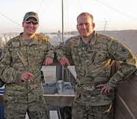 "Justin ""Buddy""  Lee (left) enjoys a cigar with fellow Chinook pilot Bryan Nichols at Forward Operating Base Shank, Afghanistan. Nichols was one of the pilots flying the Chinook shot down on Aug. 6, 2011.(Justin ""Buddy"" Lee)"