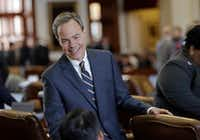 Texas Speaker of the House Joe Straus, R-San Antonio, talks with fellow lawmakers on the House floor.(Eric Gay/The Associated Press)