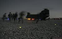 "<p>U.S. soldiers from Bravo Company, 2-87 Infantry Battalion, 3rd Brigade Combat Team and Afghan security forces conduct their final boarding maneuver<span style=""font-size: 1em; background-color: transparent;""> </span><span style=""font-size: 1em; background-color: transparent;""></span><span style=""font-size: 1em; background-color: transparent;"">before departing on a Chinook helicopter at Forward Operating Base Pasab in Zahri district, Kandahar province southern Afghanistan on August 15, 2011 </span><span style=""font-size: 1em; background-color: transparent;"">to conduct a combined air and ground assault operation.</span></p>(Romeo Gacad/AFP/Getty Images)"