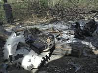 "<p>Wreckage of the Chinook helicopter at the site of the crash killing 30 Americans and eight Afghans. <span style=""font-size: 1em; background-color: transparent;"">The helicopter that insurgents shot down burst into flames before hitting the ground, leaving wreckage scattered on both sides of a river, witnesses told The Associated Press.</span></p>(Mohammad Nasir/AP)"