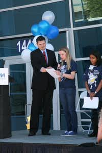 Carrollton-Farmers Branch ISD middle school students presented essays they wrote on what technology would look like in the future at the 2012 opening of Maxim Integrated's new building in Farmers Branch.