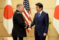 U.S. Army Chief of Staff Gen. Mark Milley (left) visit with Japanese Prime Minister Shinzo Abe in Tokyo in September. Milley plans to attend the Greater Dallas Veterans Day Parade on Nov. 10.(Toru Yamanaka/The Associated Press)