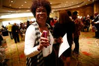 Debra Cotton smiles after she found out she just got a job with UPS during the You're Hired Job Fest Thursday at the Sheraton Hotel in downtown Dallas.(Nathan Hunsinger/Staff Photographer)
