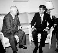 Soviet Premier Nikita Khrushchev and President John F. Kennedy talk in the residence of the U.S. Ambassador in a suburb of Vienna. (1961 File Photo/The Associated Press)