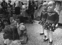 Two-year-old twins Caroline and Margaret Rebensdorf watch a clown show while attending the Hyer  Preschool Association Halloween Party Tuesday on Oct. 31, 1989. A haunted house, stories and treats were provided for the preschoolers(Richard Wright)