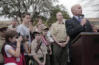 Collin County Judge Keith Self (right) and Collin County Commissioner Chris Hill (behind Self) spoke to supporters of the Boy Scouts' ban on gays as they  demonstrated and prayed outside the Boy Scouts of America headquarters in Irving in 2013.(DMN file photo)