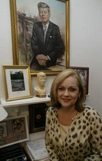 """Debra Conway posed in her Southlake office in 2003. """"It's human nature to create your own scenario than take anything at face value,"""" said Conway, a Texas resident and president of JFK Lancer, an assassination research group that gathers annually in Dallas.(File Photo/The Associated Press)"""