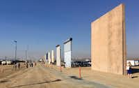 Contractors have completed eight prototypes of President Donald Trump's proposed border wall with Mexico, triggering a period of rigorous testing to determine whether they can repel sledgehammers, torches, pickaxes and battery-operated tools.(Elliott Spagat/The Associated Press)
