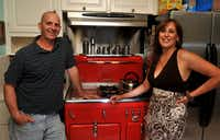 Van and Elsa Moushegian with with their 1950s-era Chambers stove at their home in Dallas on June 4, 2010. The vintage, natural-gas stove features a top broiler and a deep-well slow cooker as well as innovative safety features(Mark M. Hancock/NewsEagles.com)