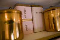 A view of vintage canisters owned by the Higginbothams. Lee and Melissa Higginbotham own a working vintage 1956-57 GE fridge and a GE stove and oven which came with the house they bought over 20 years ago. They also own other vintage kitchen items ranging from a cake carrier to canisters. Juan Guajardo/ Special Contributor(JUAN GUAJARDO)