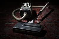 1950s-era Electrolux canister vacuum that Mitchell Kauffman has at his home in Dallas .(Kye R. Lee/Staff Photographer)
