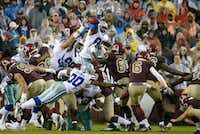 Dallas Cowboys defensive end Tyrone Crawford (98) blocks a field goal attempt by Washington Redskins kicker Nick Rose (6) during the second quarter Sunday at FedEx Field in Landover, Md.(Jae S. Lee/Staff Photographer)